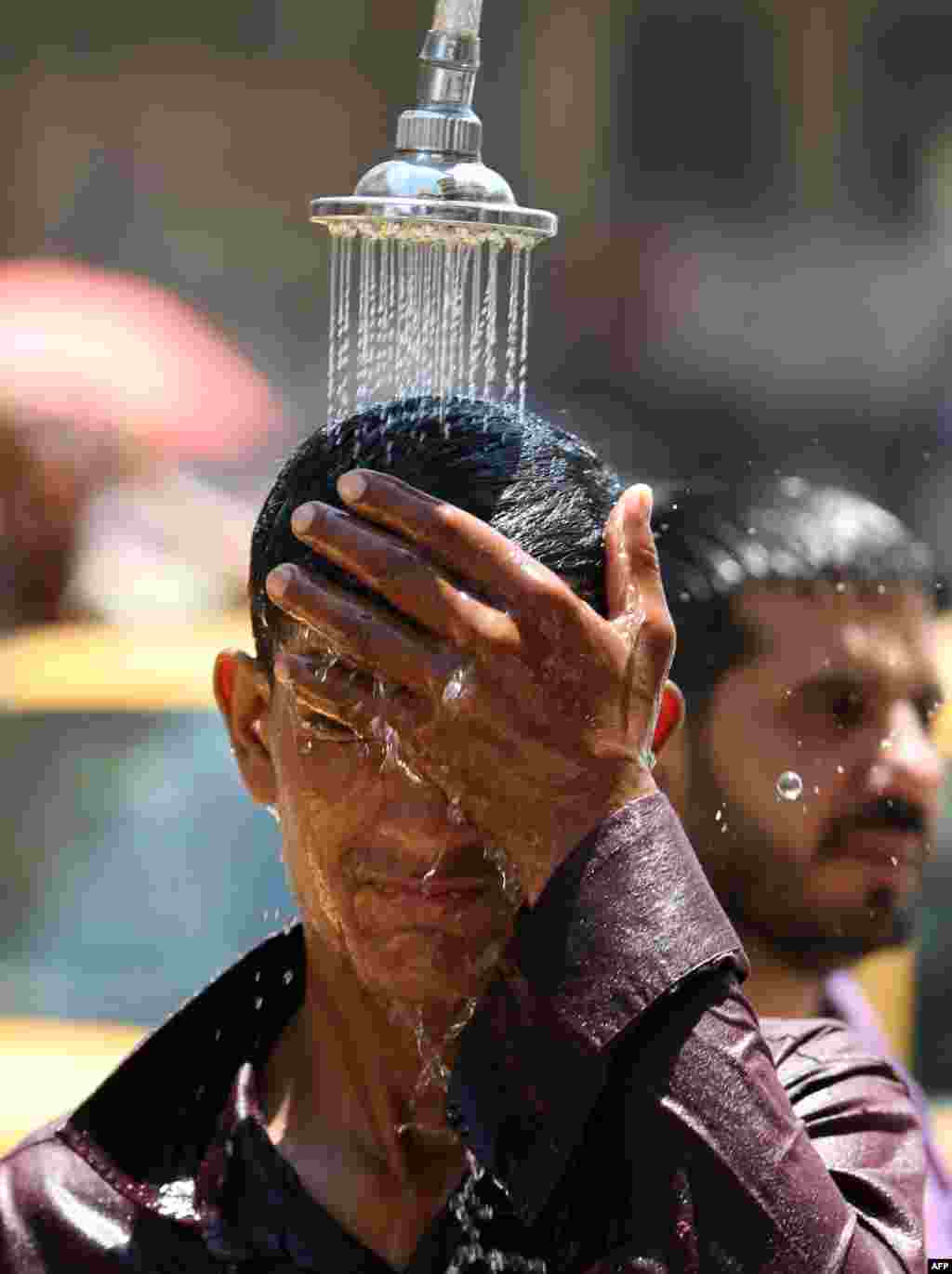An Iraqi man tries to cool off as temperatures reached 48 degrees Celsius in Baghdad on July 26. (AFP/Ahmad al-Rubaye)