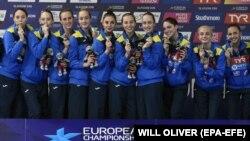 Українські представниці синхронного плавання, які здобули «золото» на чемпіонаті Європи в командній комбінації. Велика Британія, Глазго, 5 серпня 2018 року