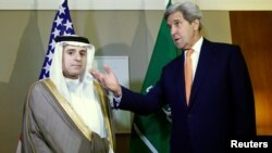 U.S. Secretary of State John Kerry (right) gestures next to Saudi Foreign Minister Adel al-Jubeir in Geneva on May 2