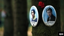 At the Levashovo mass grave site outside St. Petersburg, plaques on trees mark the spots where the victims of Soviet dictator Josef Stalin's purges were buried.