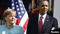 Германия канцлері Ангела Меркель (сол жақта) мен АҚШ президенті Барак Обама. Ақ үй, Вашингтон, 7 маусым 2011 жыл.