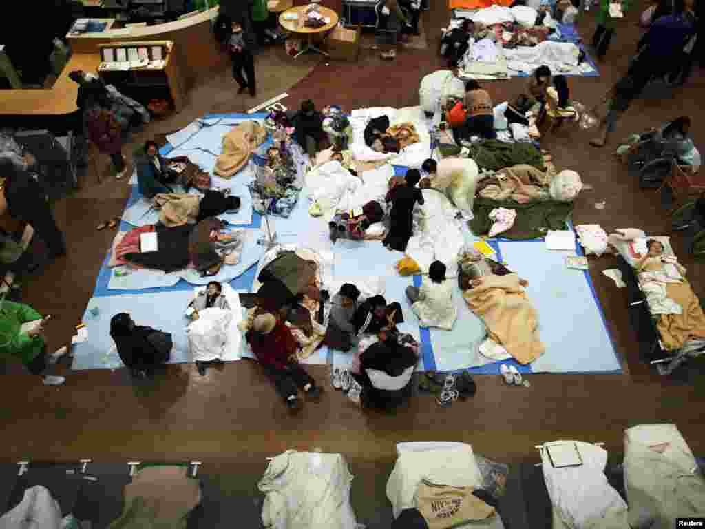 People in the city of Ishinomaki are given first aid at a Red Cross hospital on March 13 after being evacuated