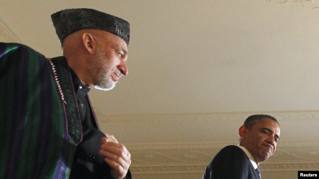 """The New York Times"" report suggested a video conference that ""ended badly"" between Afghan President Hamid Karzai (left) and U.S. President Barack Obama highlighted ""slowly unraveling"" relations between the two leaders."