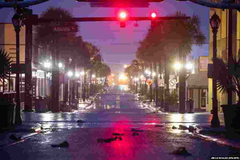 With a mandatory evacuation order in effect, the streets are deserted in downtown Daytona Beach, Florida, as Hurricane Dorian passes 90 miles offshore on September 4. (epa-EFE/Jim Lo Scalzo)