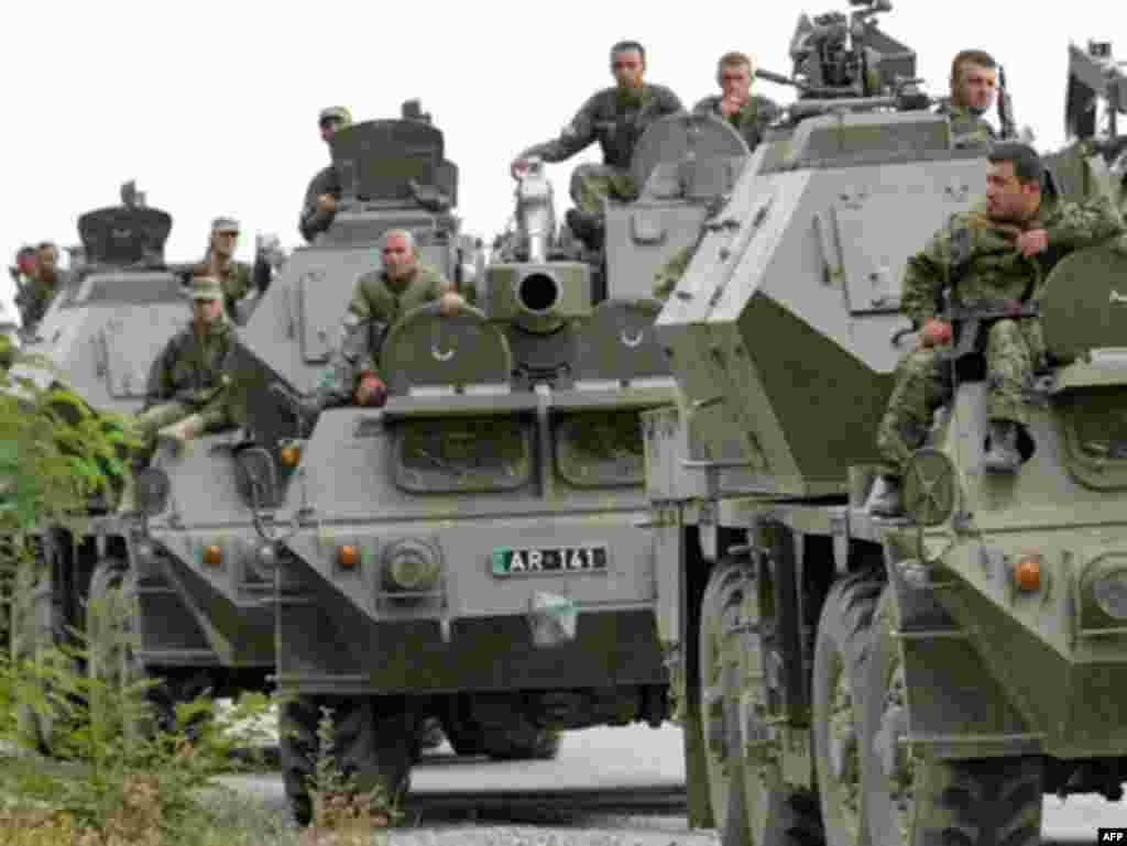 "Georgian troops on armored personnel carriers enter South Ossetia. Earlier today, Georgia said its soldiers had seized the ""greater part"" of the breakaway province after heavy fighting erupted overnight."