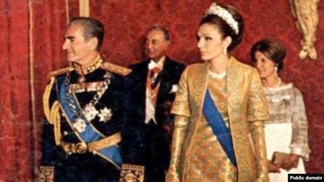 The last shah of Iran, Mohammad Reza Pahlavi (left), with his wife, Farah Pahlavi, in a royal ceremony (undated).
