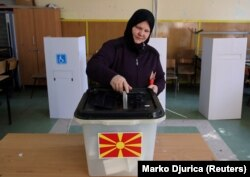 A woman casts her ballot in Skopje on September 30.