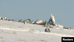The remains of an Antonov An-72 military transport plane after it crashed near Shymkent in December 2012 -- Asqar Buldeshev was charged with fraudulent activities related to the repair of air force equipment.