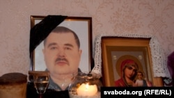 A photo of Henadz Kozyur, one of 14 workers who died in the October explosion at the plant, at his family home.