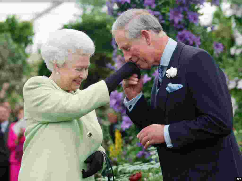 The queen's eldest son and heir apparent, Prince Charles, kisses his mother's hand at a Royal Horticultural Society event in 2009.