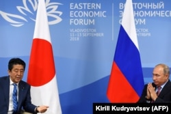 Russian President Vladimir Putin (right) meets with Japanese Prime Minister Shinzo Abe in Vladivostok on September 10.