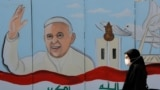 IRAQn-nA mural of Pope Francis is seen on the wall of a church upon his upcoming visit to Iraq, in Baghdad, Iraq February 22, 2021
