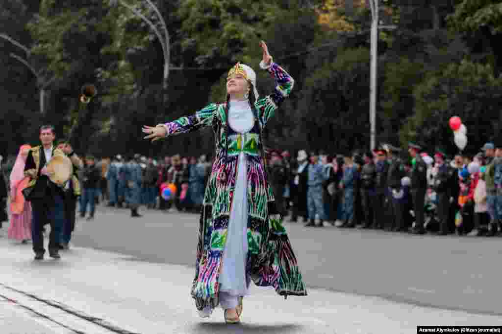 A woman takes part in Osh's 'City Day' celebrations in Kyrgyzstan on October 5.