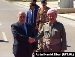 Kurdish leader Masud Barzani (right) with Iraqi Prime Minister Haidar al-Abadi in 2015
