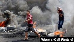 Pamje nga protestat në Irak.