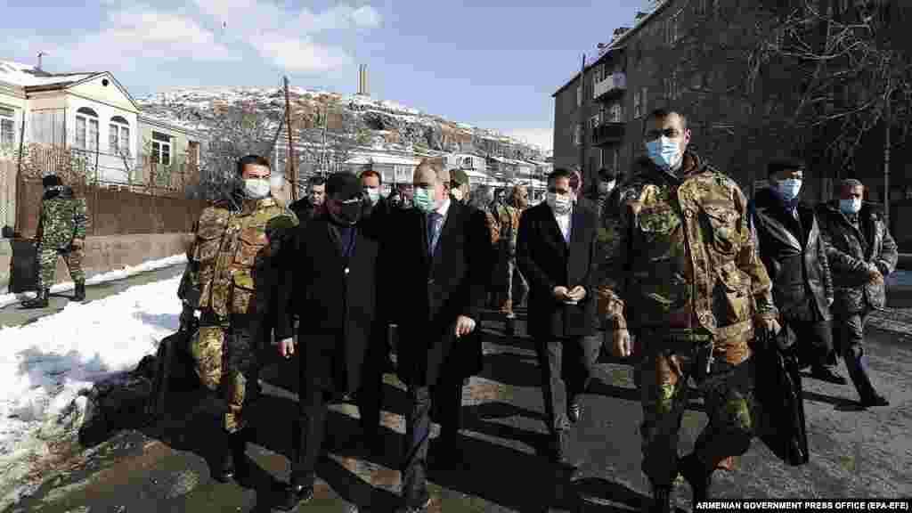Pashinian (center) walks through Sisian in the Syunik region. The December 21 visit turned into a public-relations disaster for the embattled prime minister as crowds blocked his motorcade and he was forced to travel by helicopter to the southern Armenian town.