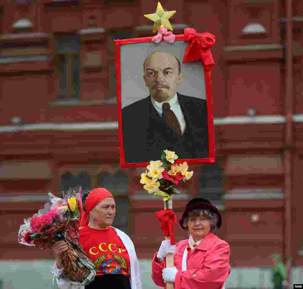 Communist Party supporters gather to lay flowers at the Mausoleum in Moscow of Vladimir Lenin on April 22, the 144th anniversary of the Soviet founder's birth. (ITAR-TASS/Valery Sharifulin)