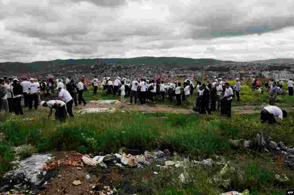 Volunteers remove garbage during a cleaning operation in Pristina, Kosovo. In 2012, more than 80,000 people removed 10,000 tons of garbage in a day. (AFP/Armend Nimani)
