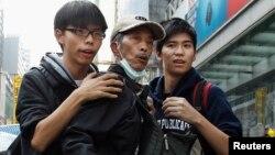 Джошуа Вонг (л) і Лестер Шум (п), Гонконг, 26 листопада 2014 року