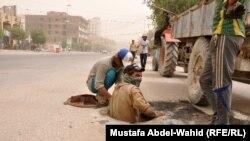 عمال المجاري في كربلاء