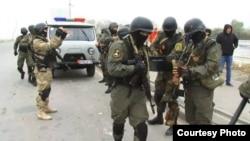 Kyrgyzstan -- Bishkek. Police searching for fugitive extremists combs Botanical Garden