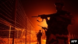 Indian border forces patrol along a fence at an outpost near the disputed India-Pakistan in Kashmir. (file photo)
