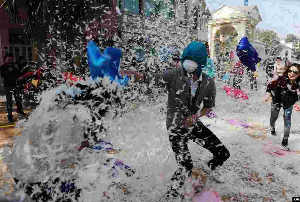 People engage in a pillow-fight game in Changsha, China, to celebrate ahead of International Women's Day. (AFP)