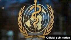 Лого Всесвітньої організації охорони здоров'я на будівлі її штаб-квартири