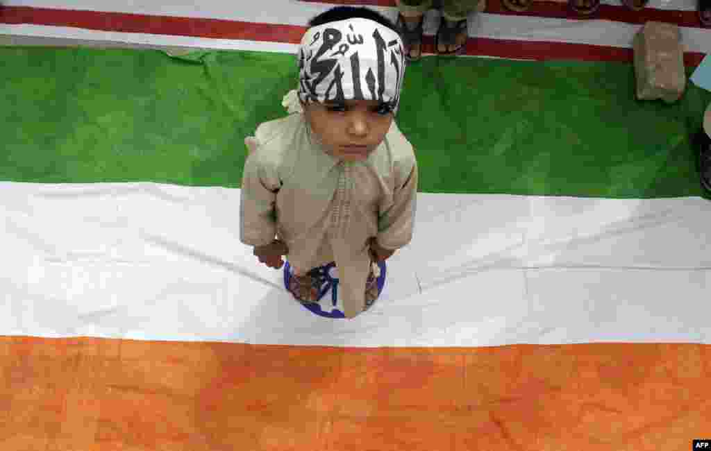 A Pakistani boy stands on an Indian flag during a protest in Quetta. (AFP/Banaras Khan)