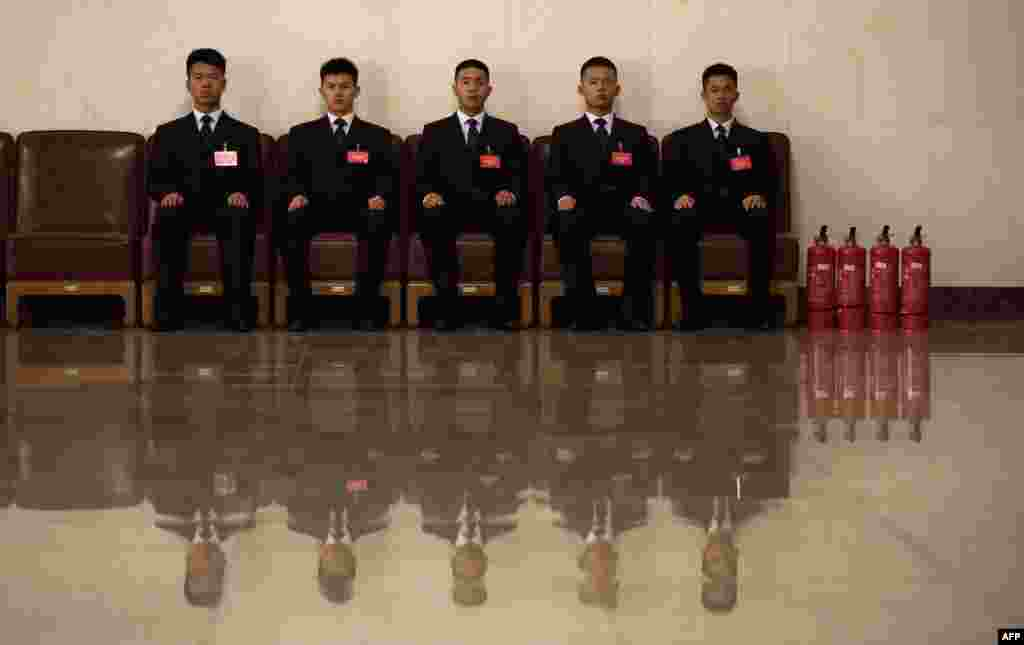 Security guards sit outside the Great Hall of the People ahead of the opening session of the Fourth Session of the 12th National Committee of the Chinese People's Political Consultative Conference (CPPCC) in Beijing on March 3. (AFP/Johannes Eisele)