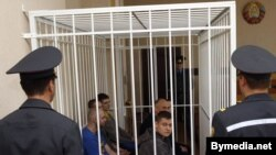 Dzmitry Vus and Mikalay Statkevich in the dock along with fellow defendants Alyaksandar Klaskouski, Alyaksandar Kvyatkevich, Artsyom Hrybkou, Dzmitry Bulanau, and Andrey Pazniyak in Minsk on May 11