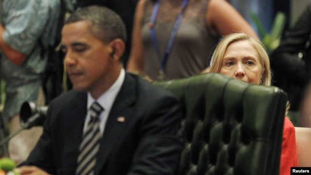 U.S. Secretary of State Hillary Clinton looks on from behind President Barack Obama's seat during an ASEAN-US Summit in 2011.