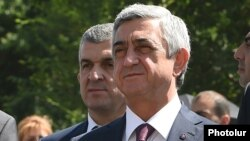 Armenia - President Serzh Sarkisian and his chief bodyguard Vachagan Ghazarian (L), 11 July 2015.