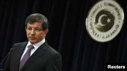 Turkey -- Foreign Minister Ahmet Davutoglu addresses the media in Ankara, 20Jan2012