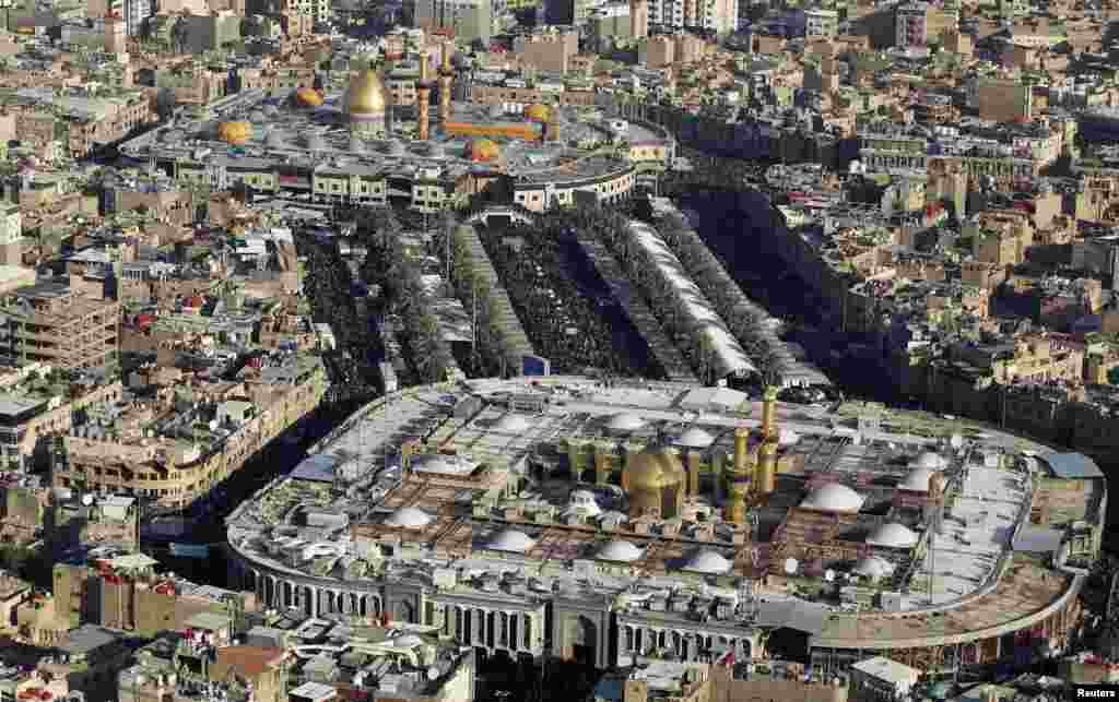 An aerial view shows the shrines of Imam al-Abbas and Imam al-Hussein during the religious ceremony of Arbain in Karbala on January 2, 2013. (Reuters/Muhammad Amin)