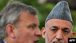 President Karzai (right, with NATO Secretary-General Jaap de Hoop Scheffer) faces intense public pressure over civilian killings