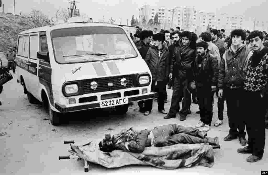 Azerbaijanis surround a victim of the Soviet crackdown in Baku starting on January 20,1990. Over several days, more than 200 people were killed and at least 700 were wounded as Soviet troops fired without warning into crowds of protesters. Ordinary citizens were targeted. The dead included Azerbaijanis, Tatars, Armenians, Russians, Jews, and Lezgins, a northeast Caucasian ethnic group.