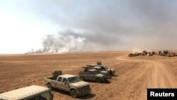 Ирактагы күрттөрдүн Пешмерга күчтөрүнүн аскерий техникасы Мосулдун түштүк-чыгышында. 14-август, 2016-жыл.