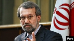 "Parliament speaker Ali Larijani accused Western powers of trying to ""cheat"" Iran."