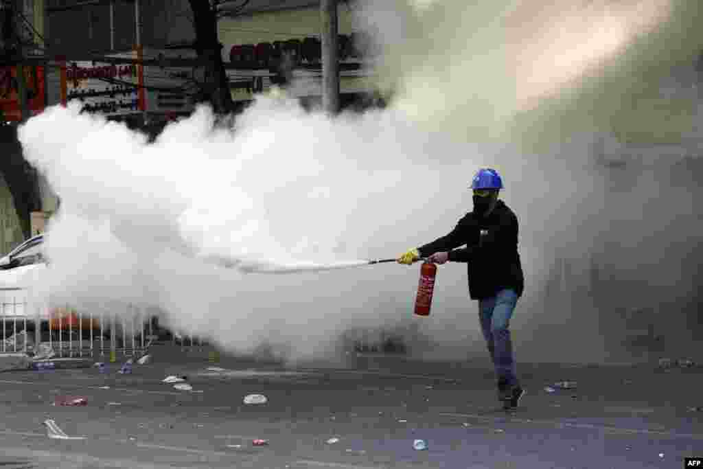 A protester lets off a fire extinguisher during a demonstration against the military coup in Yangon on March 2, 2021.