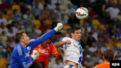 Dnipro's Nikola Kalinic (white shirt) goes for a header against FC Copenhagen in Kyiv last year.