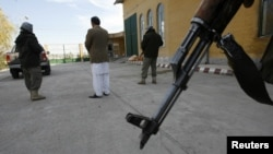 Afghanistan -- An Afghan businessman stands with his security personnels in Herat province, 11Dec2012