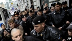 Russian police detain opposition leader Sergei Udaltsov during a rally in Moscow in September.