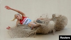 China - Darya Klishina of Russia competes in the women's long jump qualifying round during the 15th IAAF World Championships at the National Stadium in Beijing, China, August 27, 2015