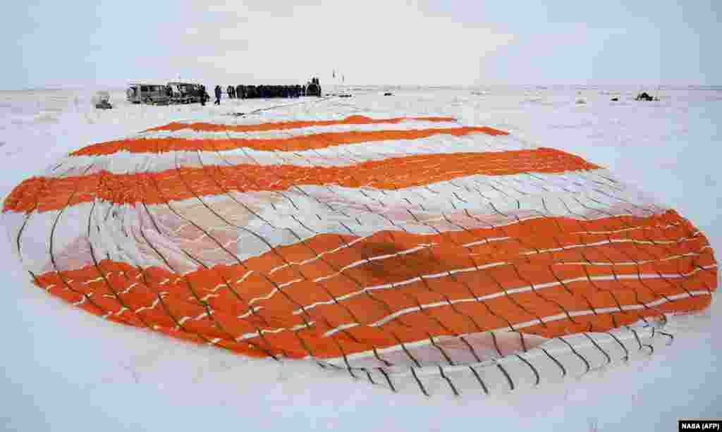 The parachute of the Soyuz MS-09 spacecraft shortly after the capsule landed with Expedition 57 crew members in a remote area of Kazakhstan on December 20, 2018. Three astronauts landed back on Earth after a troubled stint on the ISS marred by an air leak and the failure of a rocket set to bring new crew members. (AFP/NASA/Bill Ingalls)