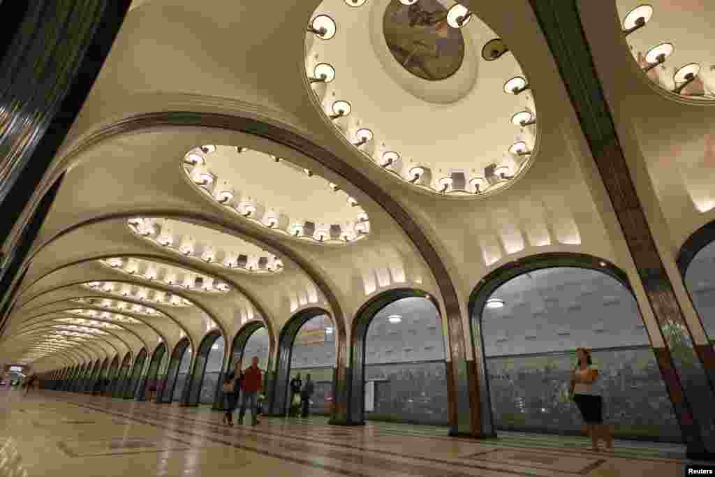 People wait for the train at the Mayakovskaya metro station, built in 1938.