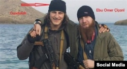 The Georgian ethnic Kist said to have been killed near Kobani, posing with Umar al-Shishani (right).
