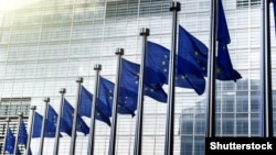 Belgium - EU flags in front of European Commission in Brussels.