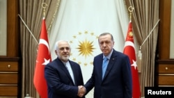File Photo Turkey - Turkish President Tayyip Erdogan meets with Iranian Foreign Minister Mohammad Javad Zarif in Ankara, Turkey, May 7, 2017.