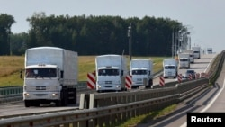 The Russian convoy of trucks carrying aid heads toward Ukraine.